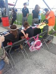 Girls 7 Boys building thier cars with Jimmy Johnson at Daytona