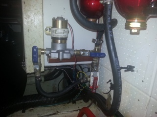 My aux electric fuel pump. The red handle is normal gravity feed to filters and then engine/generator