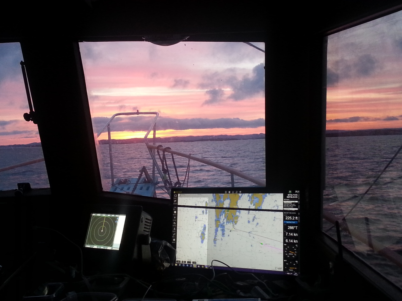 Approaching Norway. With one Monitor showing the Nav Program Coastal Explorer and the Raymarine radar display next to it.
