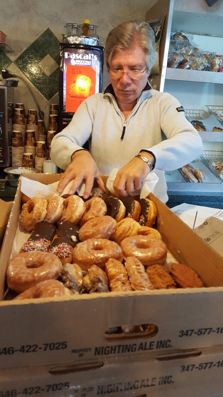 George of the Lydig Diner, puts out the day's donuts. Never a day old donut.