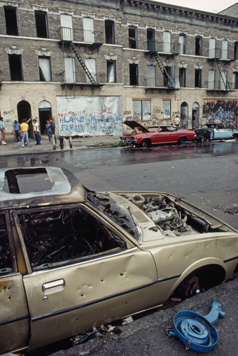 Burned out cars and dilapidated buildings on sixth street, Sunset Park in the 1980's. Photo by ROBERT MADDEN/National Geographic Creative